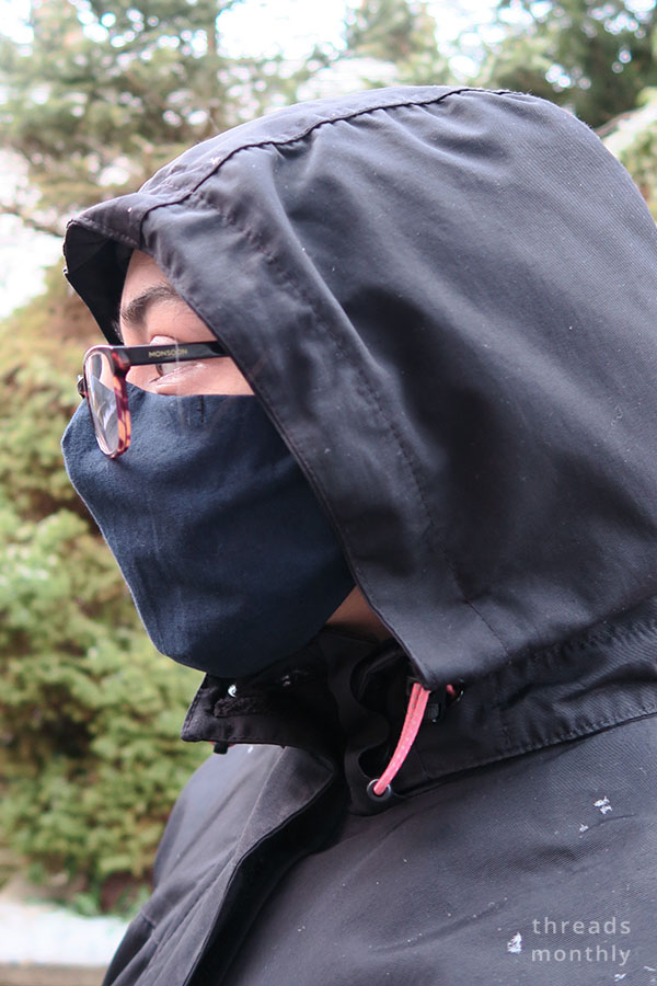 a woman wearing glasses and diy face mask with darts