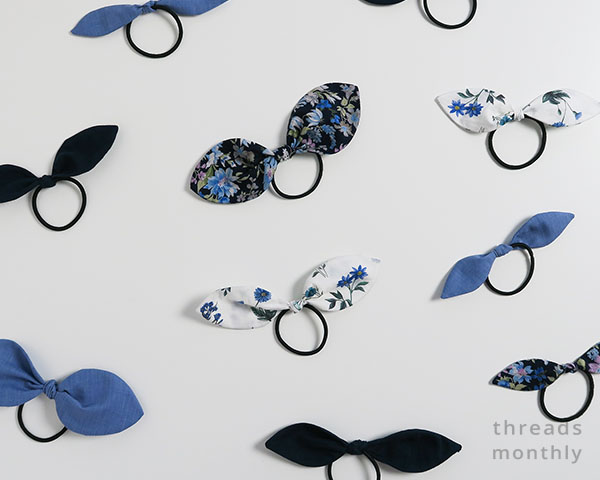 blue, white, and black hair tie bows in different sizes