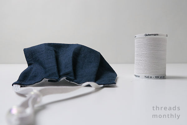 a diy pleated face mask and white thread