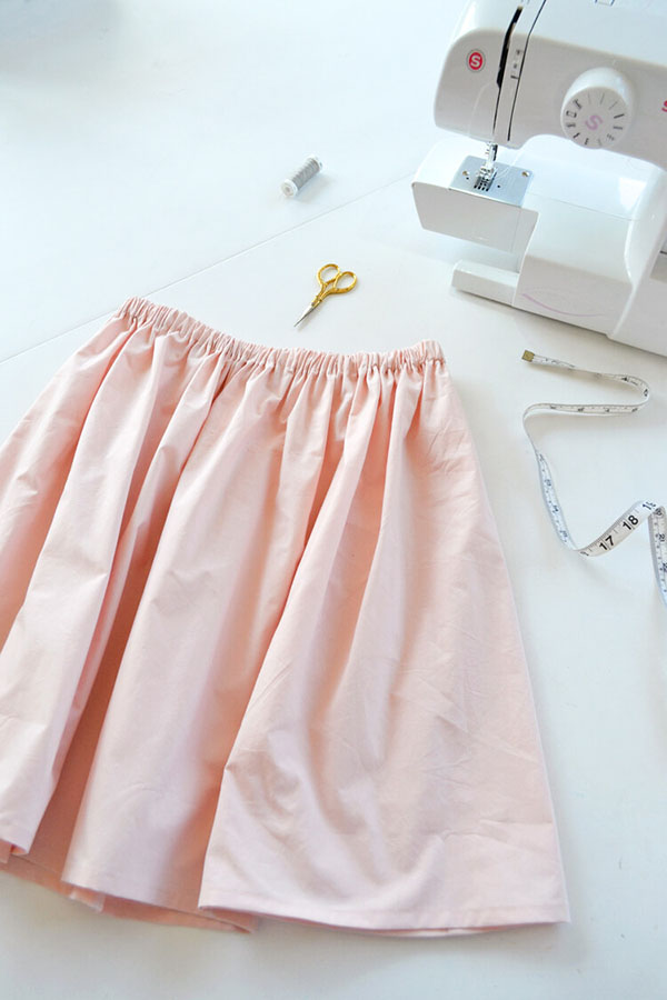 pink skirt with elastic waistband next to a sewing machine