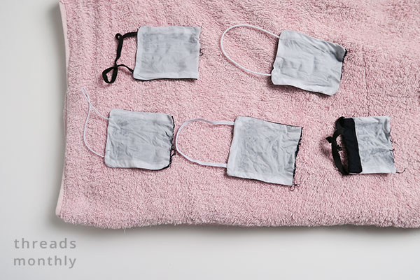 different types of elastic drying on a pink towel
