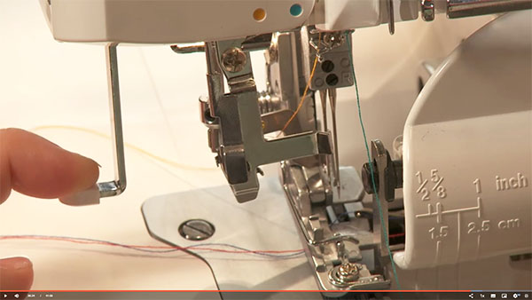 a serger needle threader being used