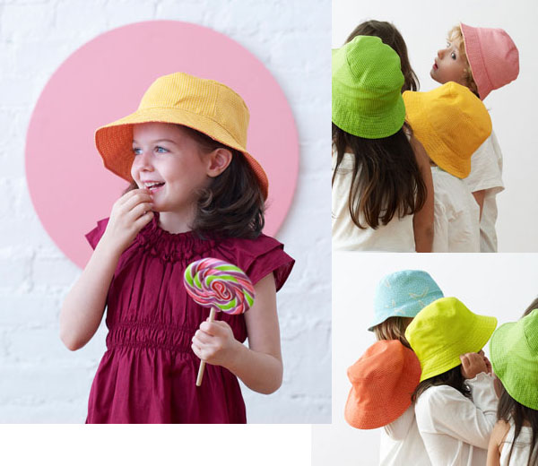 a group of children wearing neon colored bucket hats.