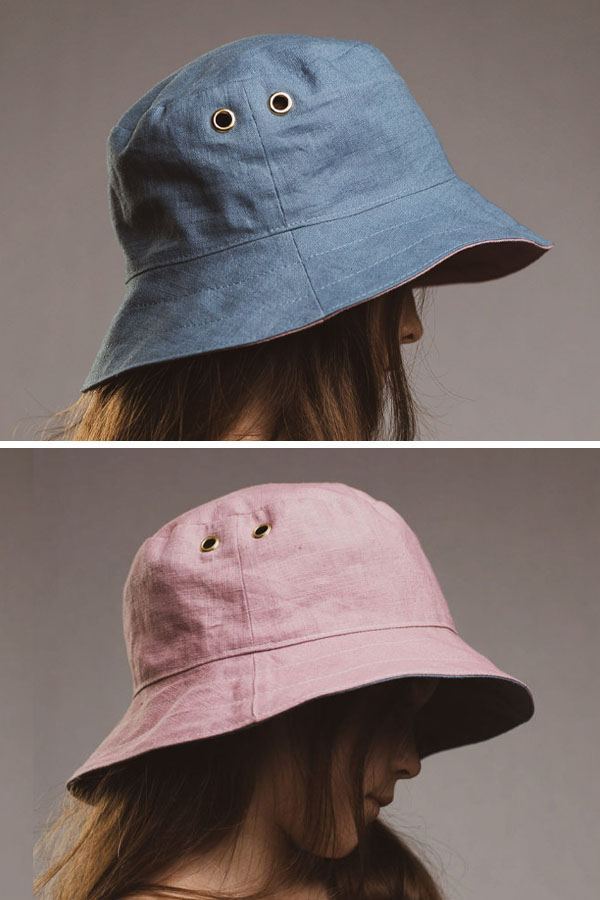 a child wearing a blue and pink reversible bucket hat.