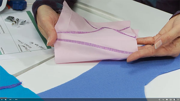 flatlock stitch samples on a pink fabric