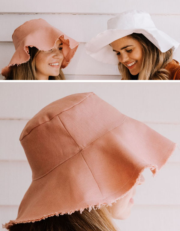 2 women wearing pink and white bucket hats for sun protection.