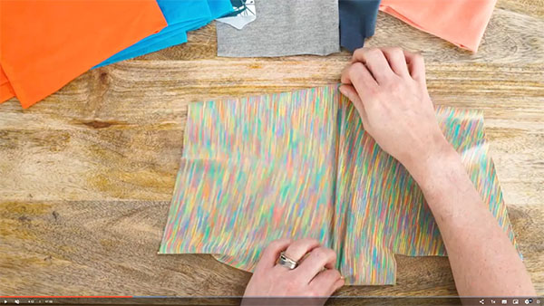 fabric sample being stretched