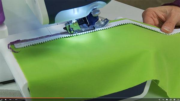 zipper being sewn on serger