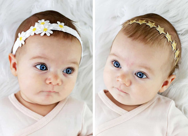 2 babies wearing elastic headbands with flowers and stars
