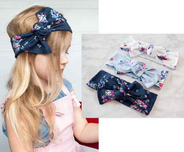 a child wearing a blue floral knotted bow headband, and 3 DIY headbands on a marble table.