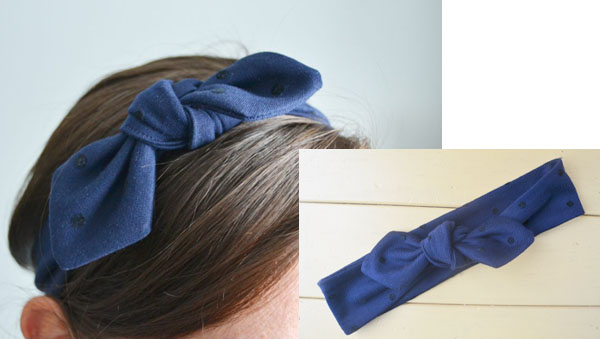 a woman wearing a blue stretchy headband with a knotted bow