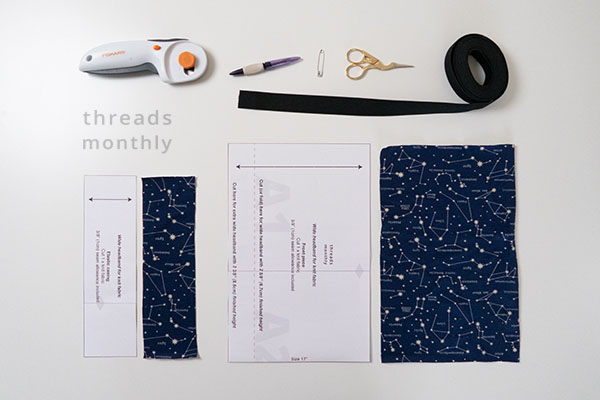 sewing tools and stretch fabric and a headband sewing pattern on a white table