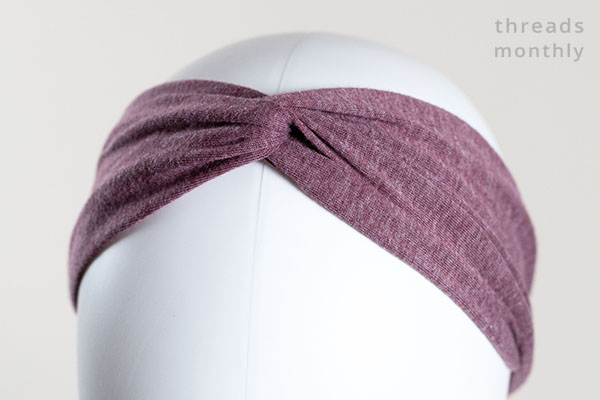 close-up of a woman mannequin wearing a twisted turban headband