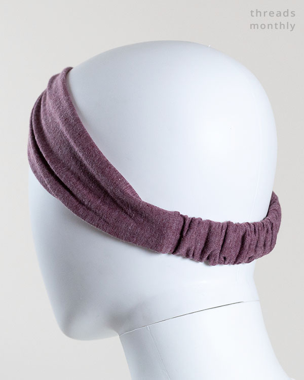 back view of a woman mannequin wearing a turban headband with elastic