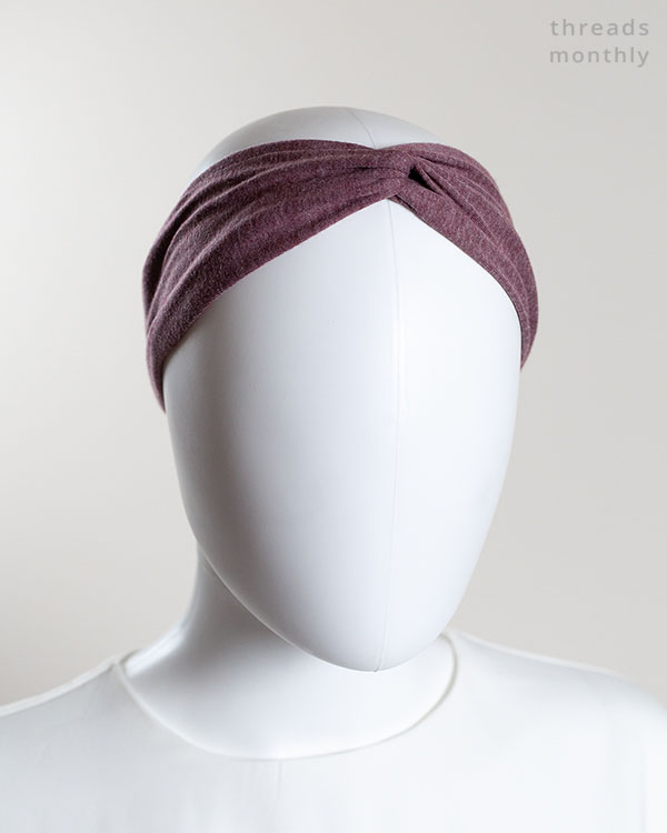 a woman mannequin wearing a twisted turban headband