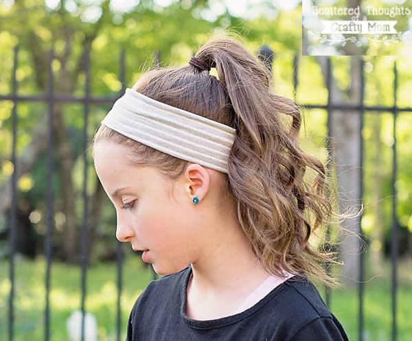 a girl wearing a stretchy headband with no elastic.