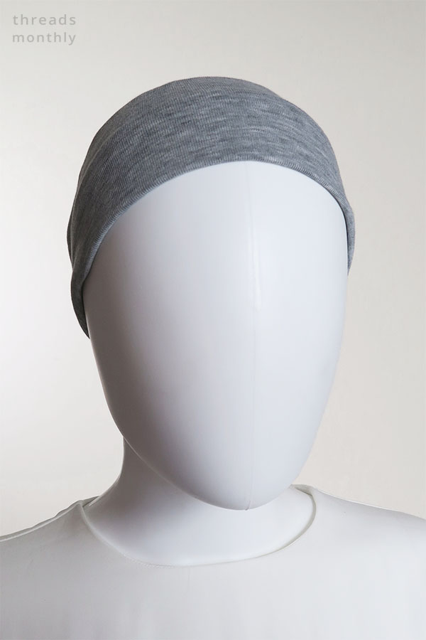 a female mannequin wearing a grey extra wide DIY headband with elastic (front view)