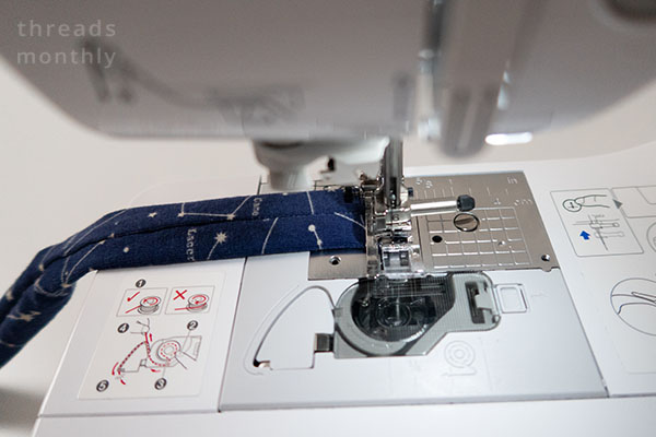 headband elastic casing being stitched on a sewing machine