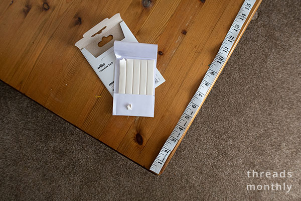 white tac and a tape measure on a table