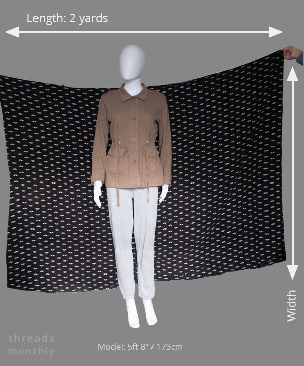 2 yards of fabric held against a mannequin